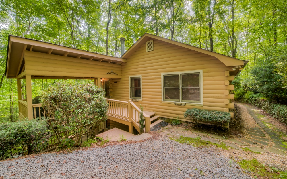 MLS #290071 - Relax on the front deck, secluded and quiet, of this 3